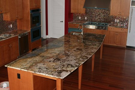 Yellow River Granite Countetops In Kitchen With A 1 X1 Gl Tile Backsplash